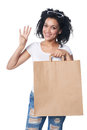 Woman with shopping bag showing four fingers