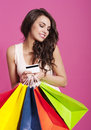 Woman with shopping bags attractive holding and credit card Stock Photography