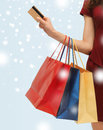 Woman with shopping bags and credit card sale gifts christmas x mas concept Royalty Free Stock Image