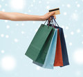 Woman with shopping bags and credit card sale gifts christmas x mas concept Stock Photography
