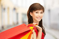 Woman with shopping bags in ctiy Stock Photos