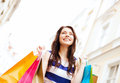 Woman with shopping bags in ctiy and tourism concept beautiful Stock Photo