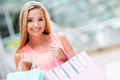 Woman with shopping bags looking very happy Stock Photography