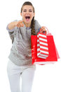 Woman with shopping bags pointing in camera Stock Photography
