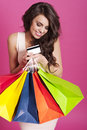 Woman with shopping bags portrait of beautiful shopaholic on pink background Royalty Free Stock Image