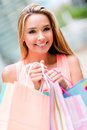 Woman with shopping bags portrait of a happy Royalty Free Stock Images
