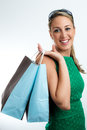 Woman with shopping bags portrait vertical of young happy smiling Stock Photo