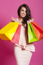Woman with shopping bags satisfied smiling after spring Royalty Free Stock Image