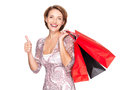 Woman with shopping bags showing thumbs up happy after gesture Stock Images