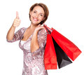 Woman with shopping bags showing thumbs up happy after gesture Stock Photography