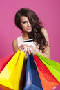 Woman with shopping bags smiling holding and credit card Royalty Free Stock Images