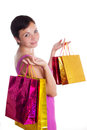 Woman with shopping bags smiling isolated on white Stock Photos