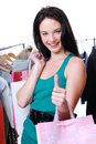 Woman  with shopping bags with thumbs-up gesture Royalty Free Stock Photo