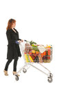 Woman with shopping cart full dairy grocery products isolated over white background Royalty Free Stock Photo