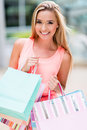 Woman at the shopping center beautiful holding bags Royalty Free Stock Photo