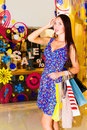 Woman in shopping center beautiful young with bags walking through the Stock Image
