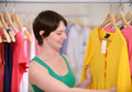 Woman shopping for clothes in a boutique Royalty Free Stock Image