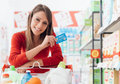 Woman shopping with a credit card Royalty Free Stock Photo