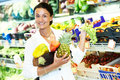 Woman shopping fruits choosing during at vegetable supermarket Royalty Free Stock Photo