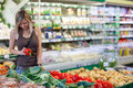 Woman shopping for fruits and vegetables Stock Photography
