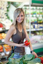Woman shopping for fruits and vegetables Royalty Free Stock Photos