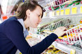 Woman shopping in grocery store Royalty Free Stock Images