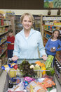 Woman shopping with kids in supermarket portrait of a smiling women son and daughter Stock Photography