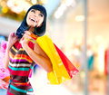 Woman in shopping mall beauty with bags Stock Photography
