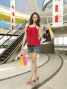Woman shopping in mall portrait of young with bag Royalty Free Stock Image