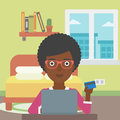 Woman shopping online using her laptop an african american holding a credit card and for at home making Stock Photo