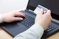 Woman shopping online using laptop closeup womans hands holding a credit card and for Stock Images