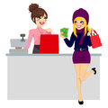 Woman shopping paying with cash young beautiful blonde purchase while store clerk is preparing bag Royalty Free Stock Photos