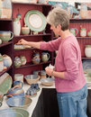Woman shopping for pottery Royalty Free Stock Photo