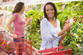 Woman shopping in produce section Stock Photography