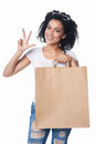 Woman with shopping showing three fingers