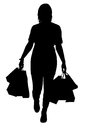 Woman shopping silhouette of a isolated on white Stock Photos