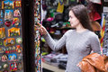 Woman shopping in souvenir store Royalty Free Stock Photo