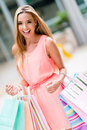 Woman on a shopping spree happy holding bags Stock Image