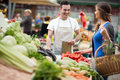 Woman shopping vegetable at street market Royalty Free Stock Photo