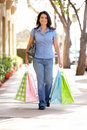 Woman Shopping walking down the street Royalty Free Stock Image