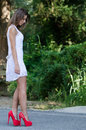 Woman in short white dress, lush vegetation as background Royalty Free Stock Photo