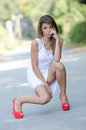 Woman in short white dress and red high heels Royalty Free Stock Photo