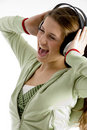 Woman shouting while listening to music Stock Photos