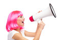 Woman shouting through megaphone Stock Photo