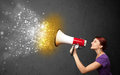 Woman shouting into megaphone and glowing energy particles explo explode concept Royalty Free Stock Photography