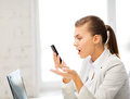 Woman shouting into smartphone bright picture of Stock Image