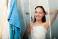 Woman showering in shower cabin cubicle girl enclosure taking care of hygiene bathroom Stock Image