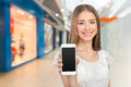 Woman showing a blank smart phone screen Royalty Free Stock Photo
