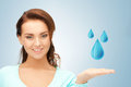 Woman showing blue water drops Stock Image