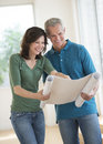 Woman showing blueprint to husband in new house happy mature women plan on Stock Photography
